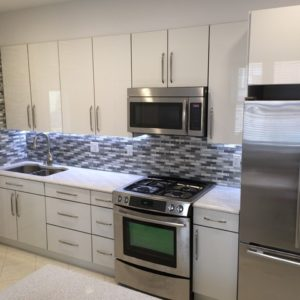DKBC-High gloss acrylic white kitchen